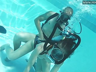 Ardent and kinky Hungarian scuba diver Minnie Manga is fucked underwater